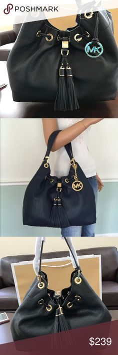 """Michael Kors CAMDEN Large Drawstring Leather Bag 100% Authentic with tag!  Style # 35S6GCDE3L Color: Black MSRP $ 398.00 Measurements: approx. 14"""" L x 12"""" H x 5.5"""" W  Product Details: Crafted from beautiful pebbled leather Dual leather handles with gold tone u-rings approx. 10"""" drop Drawstring with decorative twin tassels Magnetic snap top closure Gold tone hardware MK logo medallion hang charm at front Logo MK polyester lining with matching leather trim Interior wall - 1 zipper pocket,1…"""