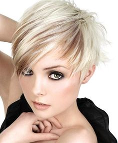 A short blonde straight coloured Multi-Tonal Rock-Chick Womens haircut hairstyle by Royston Blythe