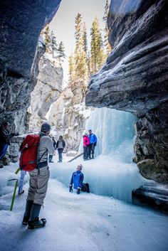 Ice hiking near Jasper, Alberta, Canada. The Maligne Canyon Ice Walk is one of the best hiking trails in Canada and one of the most scenic winter adventures in Alberta.