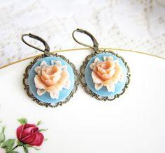 Blue Peach Earrings Flower Earrings Floral Earrings Robin Blue Duck Egg Blue Powder Blue Peach Blush Pastel Romance. $9.89, via Etsy.
