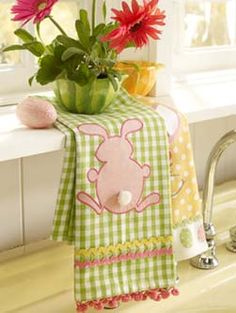 """""""bunny"""" 1 interior shot tea towels  (hanging on rack).  Light, clean, complimentary colors and the props work for the towel design ~ Trish"""