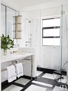 The master bath in a Hong Kong home features a sconce by Ralph Lauren Home and nickel-plated shower and sink fittings by Dornbracht | archdigest.com