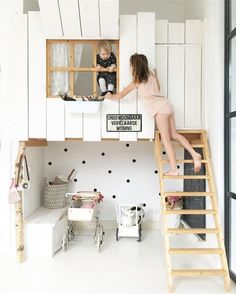 Such an adorable kids space. A birch wood ladder leads up to a fun loft. Love the clean minimal white.