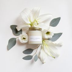 Notes of white gardenia are balanced with lily of the valley, jasmine, and muguet with a heady base of amber woods. Hand poured into elegant straight sided clear glass jars with modern minimal texture Photo Candles, Diy Candles, Scented Candles, Candle Packaging, Candle Branding, Candle Logo, Perfume Packaging, Jar Candle, White Gardenia