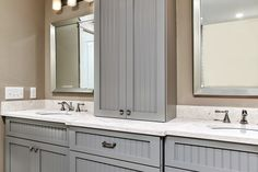Lots of room in the master bathroom, with dual vanities and plenty of storage cabinets. Love the gray and white bathroom - very soothing. The quartz countertops are a nice contrast to the gray cabinets and walls.
