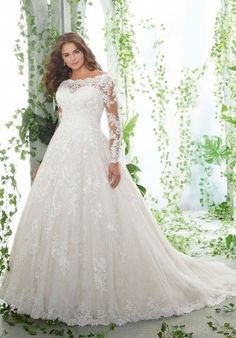 a716ef66132 A chantilly lace illusion neckline and sleeves pair with a soft tulle ball  gown skirt to