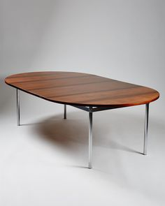 Hans Wegner; Rosewood and Brushed Steel Dining Table for Andreas Tuck, 1961.