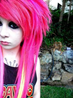 """Bright colored hair (pink) and dark make-up around eyes.  Emo girl look for the Anime Emo Punk Tech Movement of 2054 in book series, """"The Biodome Chronicles""""  by Jesikah Sundin (see board for """"Legacy"""", """"Elements"""" and """"Gamemaster"""")"""