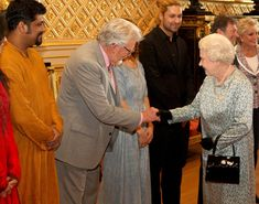 Queen Elizabeth II meets Rolf Harris during a tea party for the cast of the Diamond Jubilee Pageant at Windsor Castle on May 11, 2012 in Windsor, London.