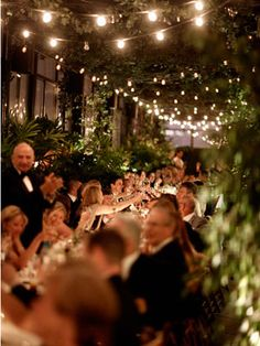 romantic wedding ideas - Sit Family-Style    The single table and family-style seating arrangement creates an intimate setting for the reception. Plus, multiple strands of overhead lights create a dining-under-the-stars illusion.