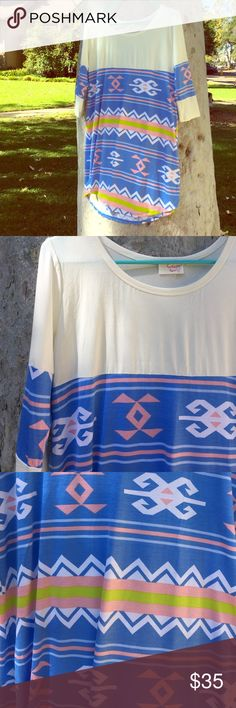 Cream Large Aztec Print Dress Beautiful dress with a large aztec print in blue and and soft pink.  ◆ 94% rayon 6% spandex ◆ care instructions: cold hand wash and hang dry  Until October 4th I will be reducing this dress from $35 to $24, as a way of celebrating my first boutique collection! Dresses