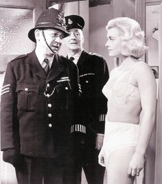 Sid James, Cyril Chamberlain & Shirley Eaton in a scene from Carry On Constable