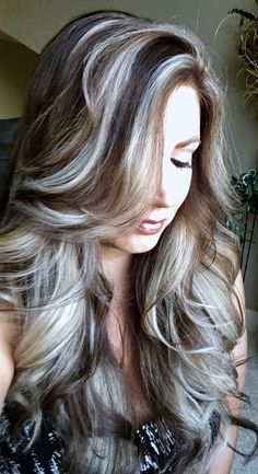 Icy blonde highlights on ash brown hair.