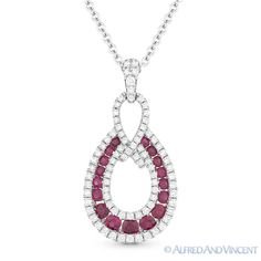 The featured pendant is cast in 14k white gold and showcases a tear-drop design adorned with round cut ruby gemstones set in channel settings and accentuated by round cut diamonds paved along the entire design.