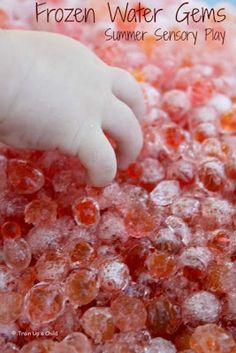 Amazing Summer Sensory Play with Frozen Water Gems- such a fun way for kids to play and explore on a hot day!