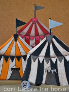 Cart Before The Horse-- Wooden hand-painted circus tents with wheels.