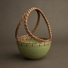 Drawing on years of experience from world travels, a fine arts degree, and working with master artists, Hannie Goldgewicht boils it all down to these simple clean lines. Basket by Hannie Goldgewicht