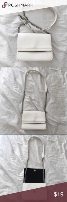 White Chain Crossbody Bag Faux leather white shoulder chain bag, flap top with a magnetic closure, an inside zipper compartment and two interior slip pockets. Can be worn cross body or over the shoulders. Forever 21 Bags Shoulder Bags