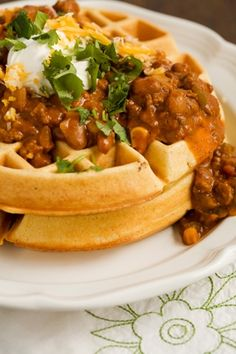 Cornmeal Waffles with Spicy Chili. This is the best chili with or without the waffles. I use 1 can each black beans & kidney beans instead of the ranch-style beans, minus the bell pepper and the corn....it is the best chili. Also the longer it cooks the better it is...