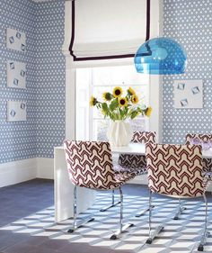 We love this light blue geometric wall paper in a dining room to make it feel less formal. Hick's Hexagon wallpaper