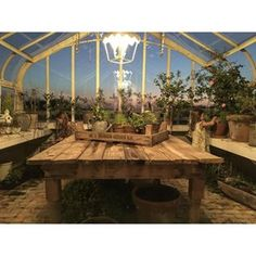 The sunset and the greenhouse were magical tonight #webelieveinfairies #plantsomething