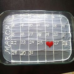 Anniversary cake simple decoration idea with their calendar month and a heart on their wedding date.