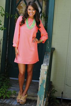 Bright pink dress with turquoise necklace and beige heels - perfect for a casual day!