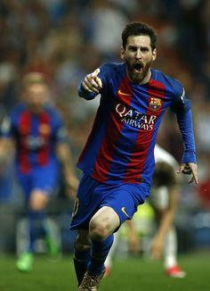 Barcelona's Argentinian forward Lionel Messi celebrates Barcelona's third goal during the Spanish league football match Real Madrid CF vs FC Barcelona at the Santiago Bernabeu stadium in Madrid on April 23, 2017. / AFP PHOTO / OSCAR DEL POZO