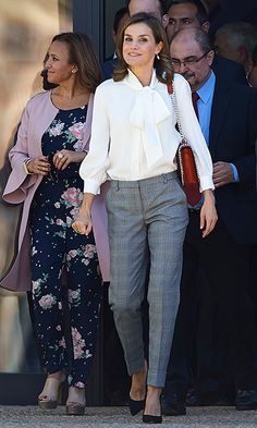 Queen Letizia of Spain was all business in grey trousers, a pussy bow blouse and Zara handbag during a visit to a school in Teruel, Spain.     Photo: Getty Images
