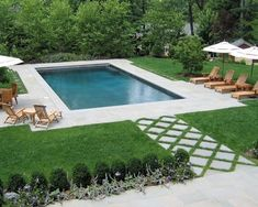 The center piece of the back yard was a rectangular swimming pool set on axis with the two rear balconies. The design included a dinning patio with a built in grill and a separate swimming pool
