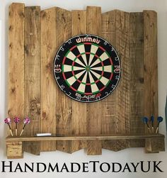 Dartboard backboard made from recycled pallet wood.