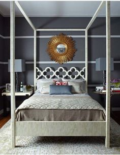 Vertical  DEF: Gives the impressions that a room is high reaching and gives the space a sense of action.   Why: The bed posts appear to reach very high and the ceiling probably looks taller than it actually is because of the bed posts.