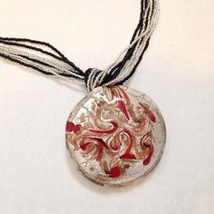 """Gorgeous Italian Art Glass Pendant / Necklace Like new. Sterling silver clasp. Italian art glass pendant and glass bead multi strand necklace 18"""" long. Can be removed from strands and used on other necklaces. Pendant is about 2"""" in diameter. Fair offers welcome. Italian Art Glass Jewelry Necklaces"""