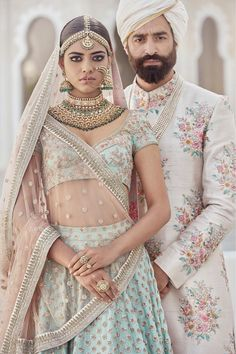 Photo of Sabyasachi mint blue and rose gold bridal lehenga and sherwani - Sabya. You can find Sherwani a. Indian Bridal Fashion, Indian Bridal Wear, Indian Wedding Outfits, Bridal Outfits, Indian Outfits, Blue Bridal, Floral Outfits, Pakistani Bridal, Bridal Dresses