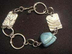 Handmade turqoiuse bracelet with silver molten by RockledgeStudios