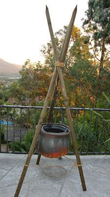 three large bamboo limbs and plastic caldron, plastic chains..perfect for a witchy yard.