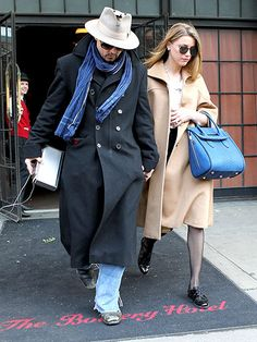 Johnny Depp and fiance Amber Heard hold hands leaving downtown NYC's Bowery Hotel on Mar. 22