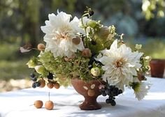 """White """"dinner plate"""" dahlias in compote"""