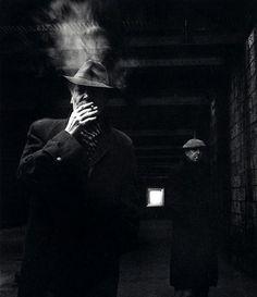 Smoking men  by Robert Doisneau