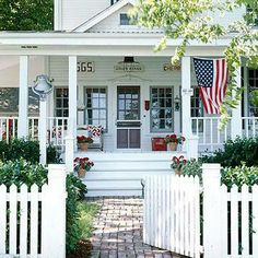 .Front yard fence! So cute! notice the flag, white steps and deco