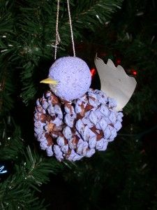 Pine cone bird ornament... inspiration like the tail,walnut for head?