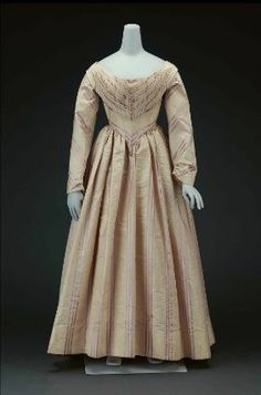 Dress of white silk moire        American, mid-19th century, about 1840         USA  Dimensions      134.6 x 61.0 cm (53 x 24 in.)  Medium or Technique      Silk striped moire and glazed cotton lining  Classification      Costumes     Accession Number      53.194  Not on view