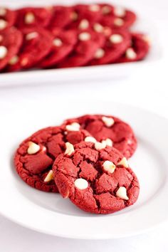 RED VELVET CHOCOLATE CHIP CHRISTMAS COOKIES  1 1/2 cup of all purpose flour  2 1/2 tbsp cocoa powder  1 tsp cornstarch  3/4 tsp baking powder  1/4 tsp salt  1/2 cup salted butter, softened  1 cup granulated sugar  1 tsp white vinegar  1 large egg  1 1/2 tsp vanilla extract  1 1/2 tsp red food coloring  3/4 cup white chocolate chip  Drop cookies by spoonful onto a greased cookie sheet.  Pre-heat oven to 375 degrees.  Bake for 9 - 11 minutes
