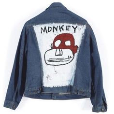 Executed in 1986 oil on Levis Strauss & Co denim jacket  by Jean Michel Basquiat sold for 77.5K USD