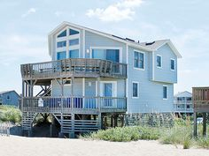 """Located on a quiet and private road, this large, comfortable home is perfect for family vacations!  With unbelievable ocean views from the decks, living, dining and kitchen areas, you will be glad you choses """"Kapadia"""" as your vacation rental on the OBX. Listen as the waves crash against the shore while you're reading a book or settling in for the night.With its location in South Nags Head, you'll be away from the busier areas of the Outer Banks, while still being a short driving distance to…"""