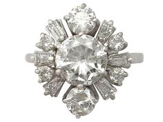 '3.17 ct Diamond Cluster Ring - Art Deco Style' http://www.acsilver.co.uk/shop/pc/3-17-ct-Diamond-and-18-ct-White-Gold-Cluster-Ring-Art-Deco-Style-Vintage-Circa-1950-35p8980.htm