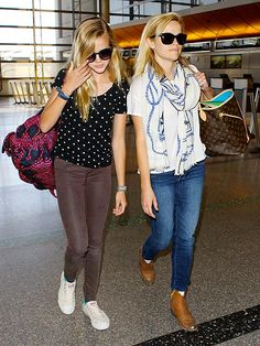 "Reese Witherspoon and her ""mini me"" daughter Ava strolled through LAX, both rocking oversized sunnies! We can't believe how much they look alike!"
