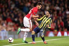 Volkan Sen of Fenerbahce challenges Matteo Darmian of Manchester United during the UEFA Europa League match between Manchester United FC and...