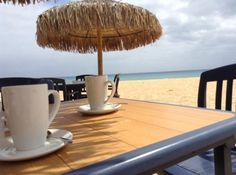 A coffeeshop on the beach and I could stay forever <3