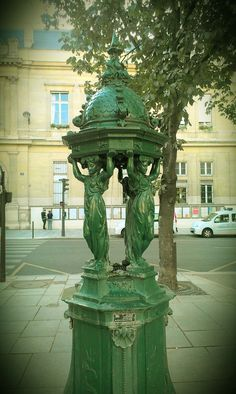 Drinking fountain at Place Saint Sulpice, Paris